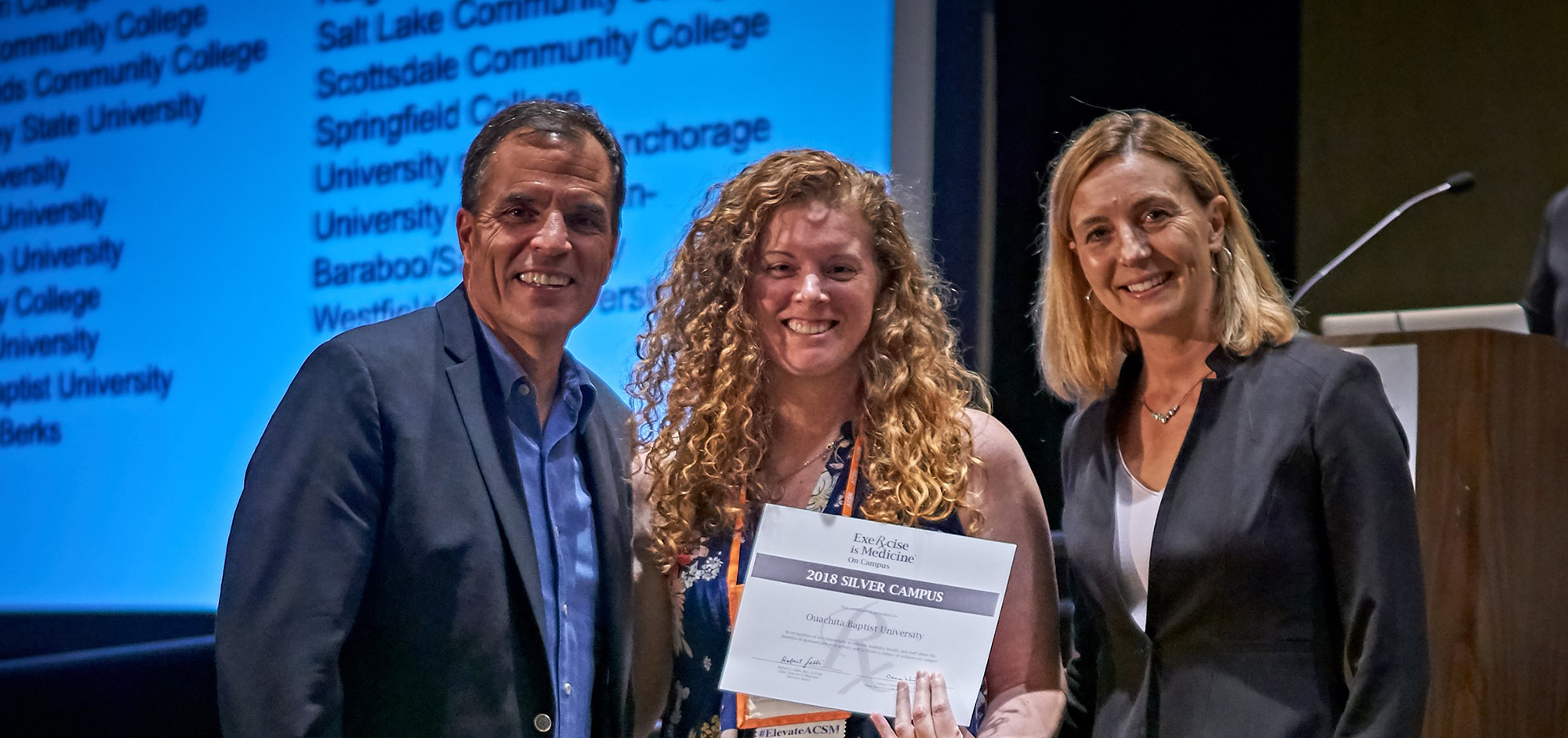 Dr. Amber Chelette, center, accepts Silver Status honors in the Exercise is Medicine® program at the national American College of Sports Medicine Summit.