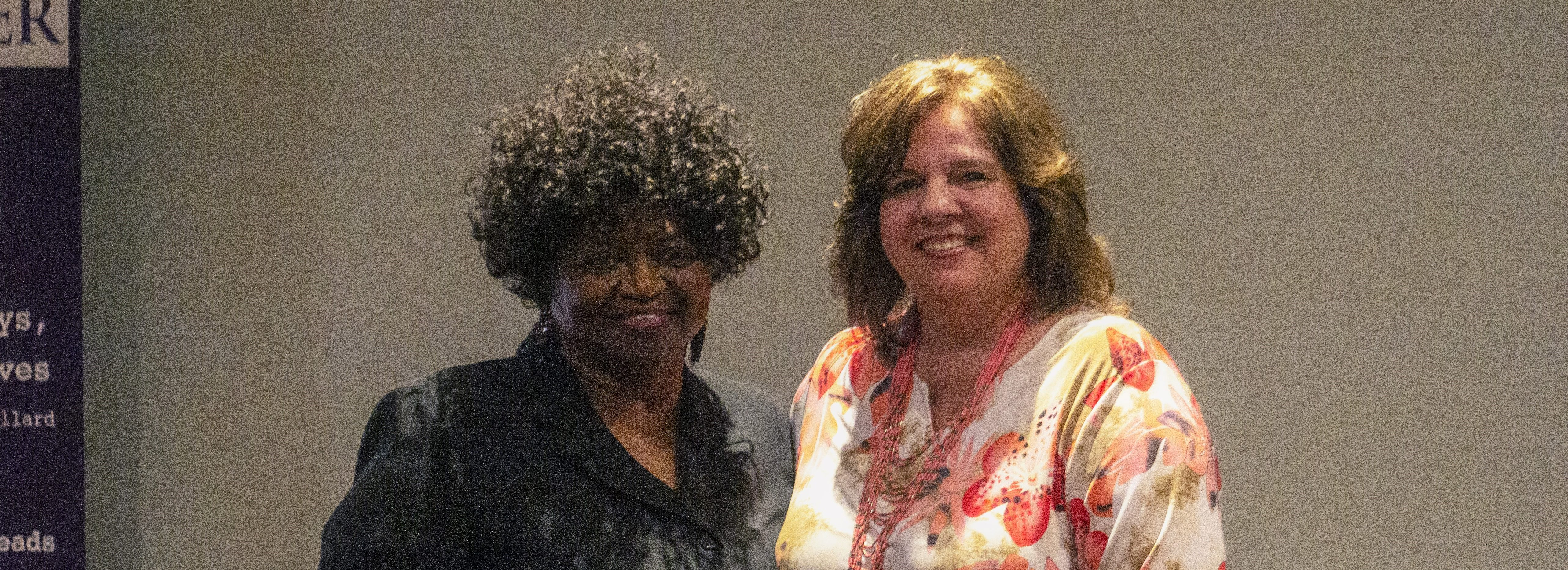 Pictured are honoree Linda Burns (left) and Donna Reynolds, director of the Foster Grandparent program at Ouachita, during the Elrod Center's annual community service awards banquet. Burns was honored for 25 years of service with the program.