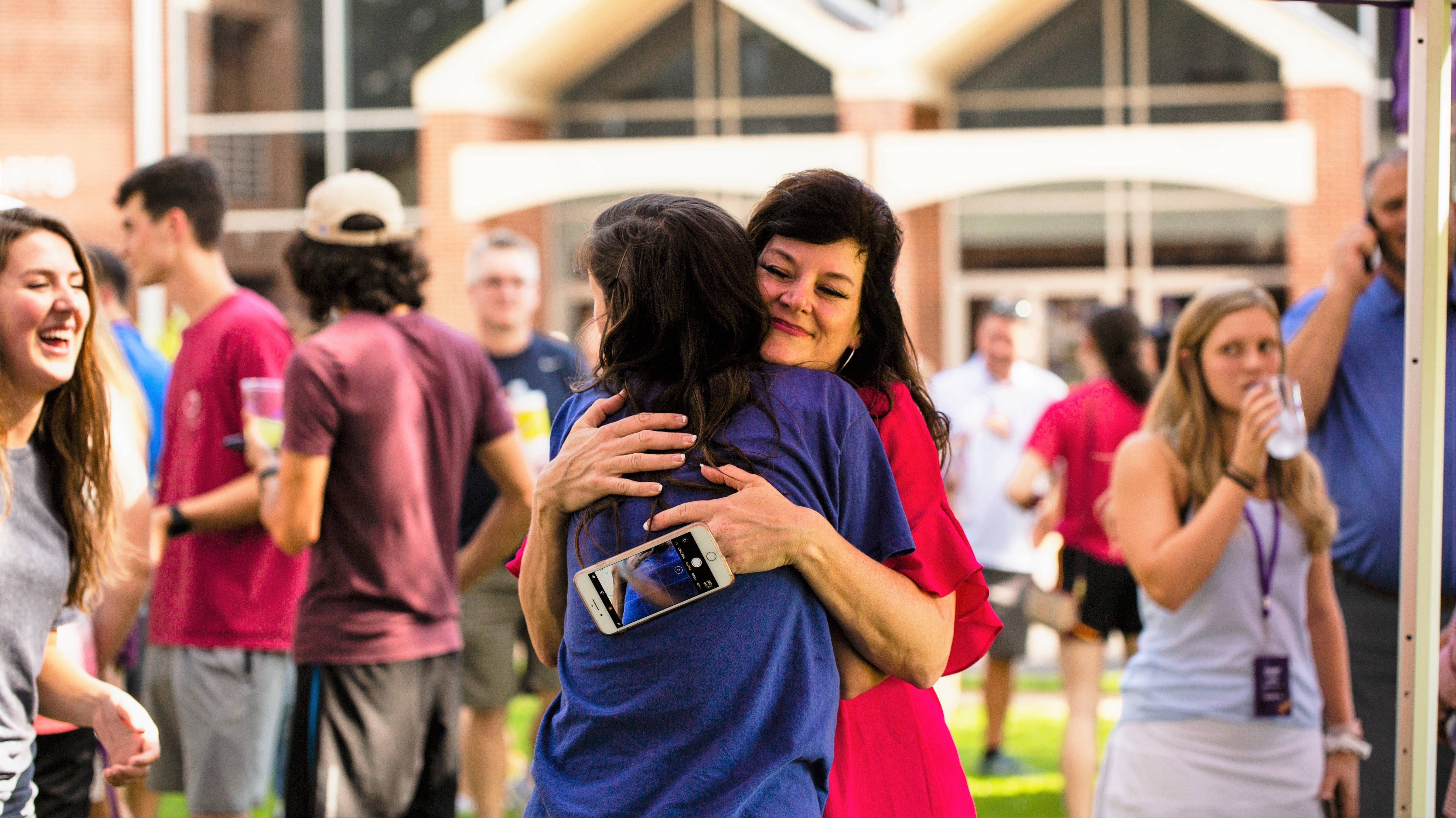 Mother hugs her daughter moving to Ouachita